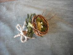 All Natural grooms boutonneir with bird's nest and moss, for a woodland, rustic, nature themed wedding..