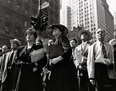 """New York. June 6, 1944. """"D-Day. Crowd watching the news line on the Times building at Times Square."""""""