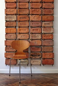 Antique bricks used as wall art. Very cool idea!