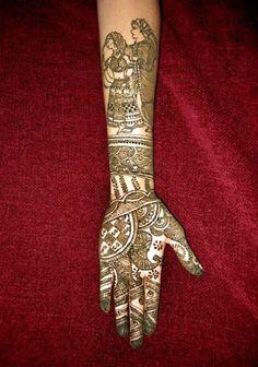 Man & Woman drawn in Bridal Mehndi