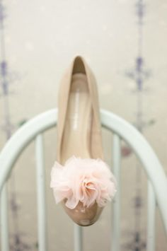 Spruce up a plain pair of heels with a DIY pom pom accessory.