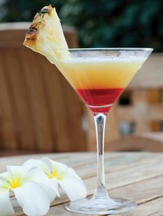 The Bikini Martini (1 oz Ketel One Vodka  1 oz Malibu Coconut Rum  2 oz Fresh Pineapple Juice  1/4 oz Grenadine)