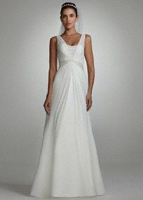 """Look like a goddess on your special day in this flowy chiffon split front gown!  Soft chiffon a-line featuring tank bodice with embellished detail at bust & at empire waist.  Split front a-line skirt is slimming & flattering on several body types.  Available in Ivory. 66"""" chapel train.  Fully lined. Imported polyester. Dry clean only."""