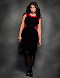 How about this for a curvy office look?  This body con dress gets sharp insets of red for a slimming modern look.