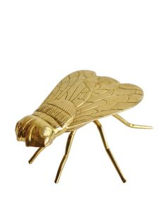 a giant brass fly
