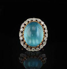 Stunning 35 carat Aquamarine and diamond ring. 20 brilliant cut diamonds G/VVS 1.5 tcw set in 18K gold. Circa 1940s