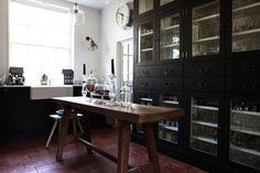 Steal This Look: English Country Kitchen : Remodelista. The black cabinet/shelves.The country sink.