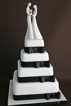 Four tier black and white wedding cake decorated with black satin ribbon and bows around each tire. Garnish with a romantic cake topper of a bride and groom dancing. From www.flickr.com Scrumptious Cakes  ........   #wedding #cake #birthday
