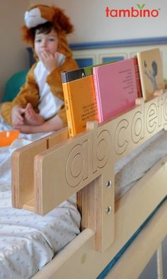 A bed safety rail and a shelf for bed time story books.
