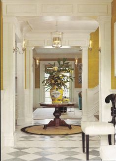 Like the position of the front door straight-lined to the backdoor, rooms off to the sides of the hallway and moulding around each open doorway