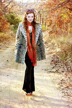 LOVE LOVE LOVE this look!  the red/orange scarf.  Faux fur coat, those PANTS!  And the shoes.