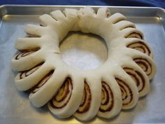 Christmas cinnamon roll wreath. Frosting in the middle for pull apart and dip!