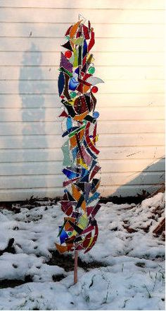 I love this 5ft. tall recycled glass lawn sculpture.  This is going on my list of things to do!