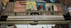Familia Deluxe vintage Knitting Machine complete with instructions and patterns. 161 stitches, automatic row counter, weights and combs not required. 12 tension settings. Automatic wool feeder supplied, can be removed for shaping and patterning. £29, W J Foster Ltd, Preston, Lancashire