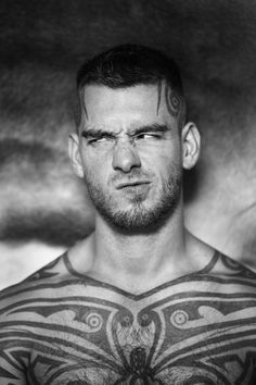 logan mccree - no need to show off half naked body, sporting a funny face... That's my kind of tattoo photographer. Fun and playful.