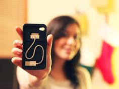 The Cord-On-Board case: it protects your iPhone AND stores a charging cable in it. So handy.