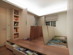 Under-the-floor storage and hideaway wall cabinets
