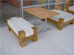 Concrete bench with wooden legs