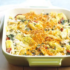 Chicken Florentine Artichoke Bake  A Parmesan cheese-bread crumb mixture tops this hearty supper featuring bow tie pasta, chicken, artichokes, and Monterey Jack cheese. Crushed red pepper adds a touch of heat.