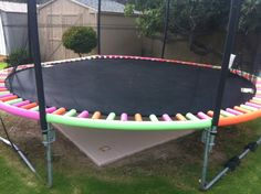 A trampoline decorated with pool noodles!