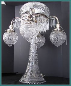 "There are absolutely no words that can really describe this cut glass lamp~There are 4 silver-plated arms extending approx. 11"" from the center base with ornate beading under each arm~There are 80 tear drop prisms which hang along and between the arms~Top globe is 37 3/4"" in circumference~Individual globes are 19"" in circumference The bottom glass base is 30"" in circumference~So much more to say but not enough room"