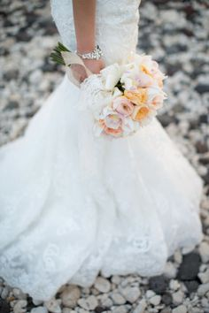 Lace wedding dress and a pastel bouquet: http://www.stylemepretty.com/destination-weddings/2014/10/20/maui-wedding-at-olowalu-plantation-house/ | Photography: Kaua Weddings - http://kauaweddingphotography.com/