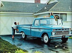 1966 Ford F100 Pick Up Truck in light blue with white wheels