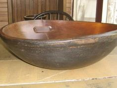 A big dough bowl I painted, stained and gave a leather repair. Really wanted to have it be a metal repair but I had to make do with what I had, making do is what primitive lovers do right?