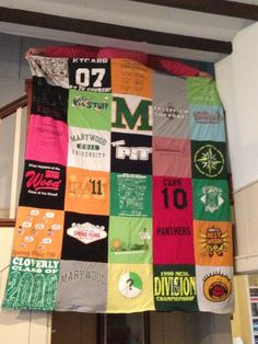 T-shirts upcycled into a blanket. I want to do this to all my old cross country t-shirts
