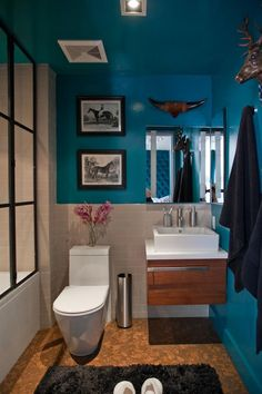 California Home & Design's Small Space, Big Style | House Tour. I love the turquoise blue walls. The toilet and sink are shaped weird. Not sure I like the cowboy theme, maybe if it was more western rustic.