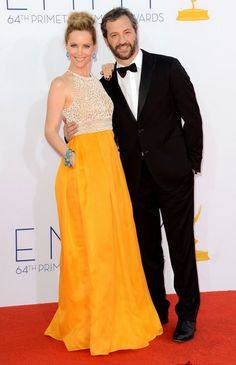 Leslie Mann wearing a yellow gown by Naeem Khan and Judd Apatow in a classy tux at the 64th Primetime Emmy Awards. #Emmys #fashion