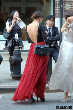 Love this classic bag, sparking, deep-v back and flowing oxblood skirt. www.fashioncompassion.ca