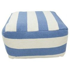 Wool pouf with blue striping.