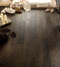 Ceramic tile that looks like wood.....perfect for a kitchen, bathroom, or basement.