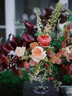 Whimsical and romantic floral centerpiece by Sarah Winward.  Photo Leo Patrone.
