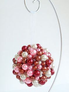 Valentine's Day kissing ball or ornament made with red, pink and white mardi gras beads