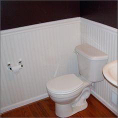 Remodeling my 50s pink bathroom. Beadboard in white, wood flooring and brown walls :)