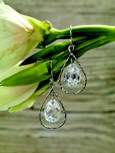 As the chosen piece for the #Silpada #Foundation, these faceted #Cubic #Zirconia and #Sterling #Silver #Earrings #sparkle with #graceful details. #Jewelry
