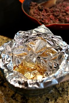 Pour your bacon grease into a foil-lined bowl then crumple and throw away when it hardens.