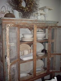 Love this chippy cabinet filled with ironstone (from Sparrow)