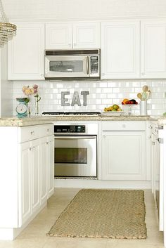 Love this kitchen! Subway tile...mmmm.