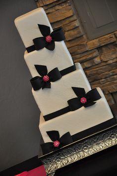 Damask with black & pink bows wedding cake