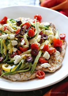 This dish is AMAZING! Thin sliced boneless pork chops are pan seared and served topped with julienned summer squash, roasted tomatoes, lemon juice, olives and Feta cheese – YUM!