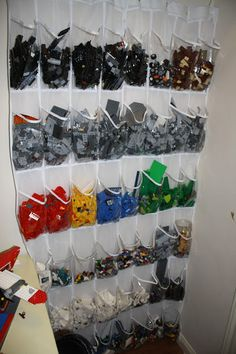 Organizing Legos in an over the door shoe hanger.  Great idea - will be setting this up for my daughter.