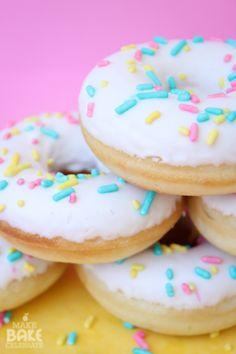 Baked yellow cake donuts with vanilla glaze (Make Bake Celebrate).