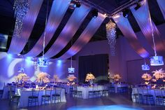 Ceiling drape, uplighting, cobalt glasses.  By Diana Gould Ltd. Bar Mitzvah in #blue #violet.  App Photography.