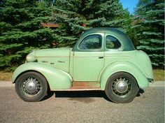 A one-off custom-built coupe created by George S. Brauks, a St. Louis, Missouri foundry pattern maker and carriage builder. The front of the car is a 1937 Hudson Terraplane 2 door coupe. The rear part seems to be a 1936 DeSoto. The entire car was narrowed lengthwise on the centerline to create a narrow body width.