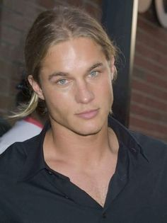Travis Fimmel. I'm a sucker for blue eyes and his are amazing!!