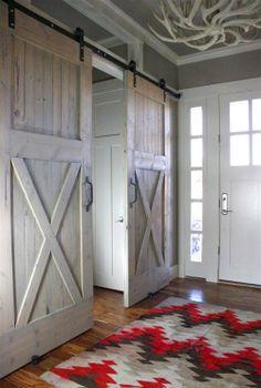 Love barn doors! I'd like to do something similar instead of window treatments for the sliding glass doors.