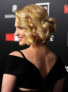 January Jones blonde bob hairstyle with smooth spiral curls